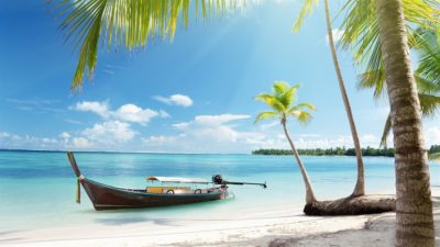 Tropical island boat on the beach.